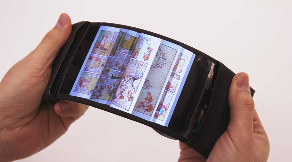 By bending a flexible smartphone, a user flips through the pages of a comic book.