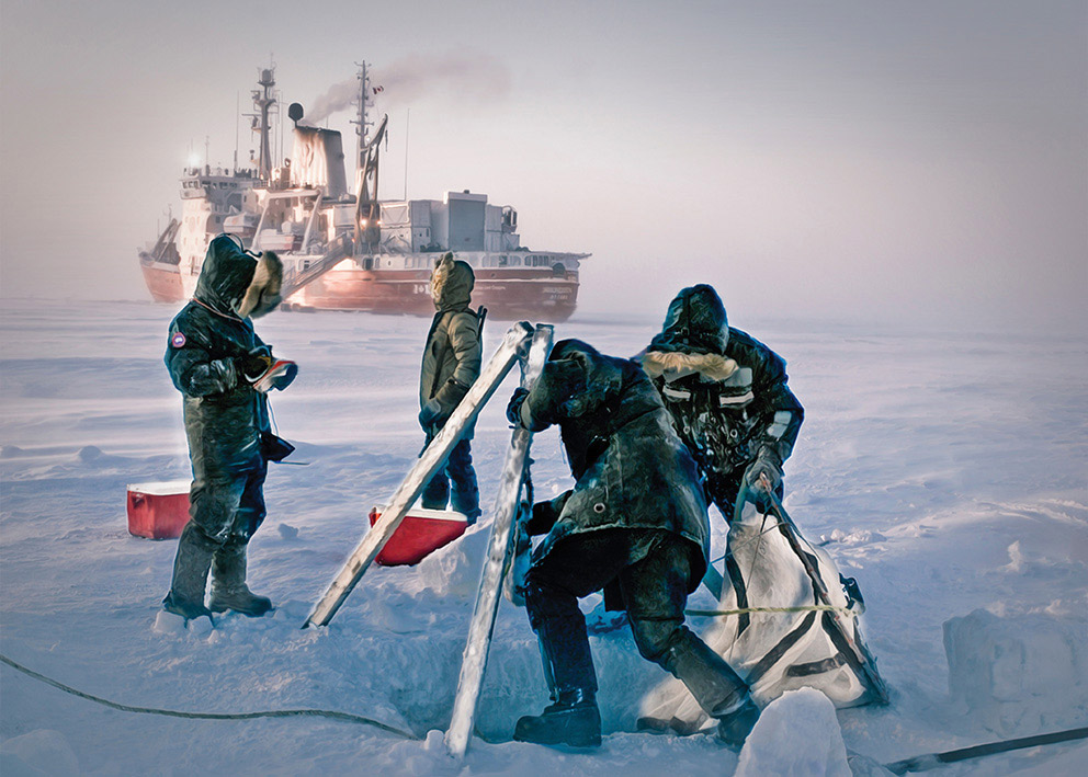 Four people set up fishing nets on the ice; a large ship is in the background