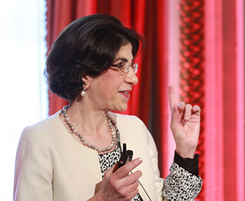 Fabiola Gianotti gestures with her hands while speaking