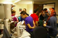 Students use the microscope to examine traces of