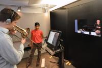 Trombonist Taylor Donaldson plays for researcher