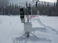 A snow-covered monitoring station atop Mount Tom.