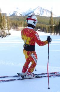 A skier dons the compact STEALTH equipment, in
