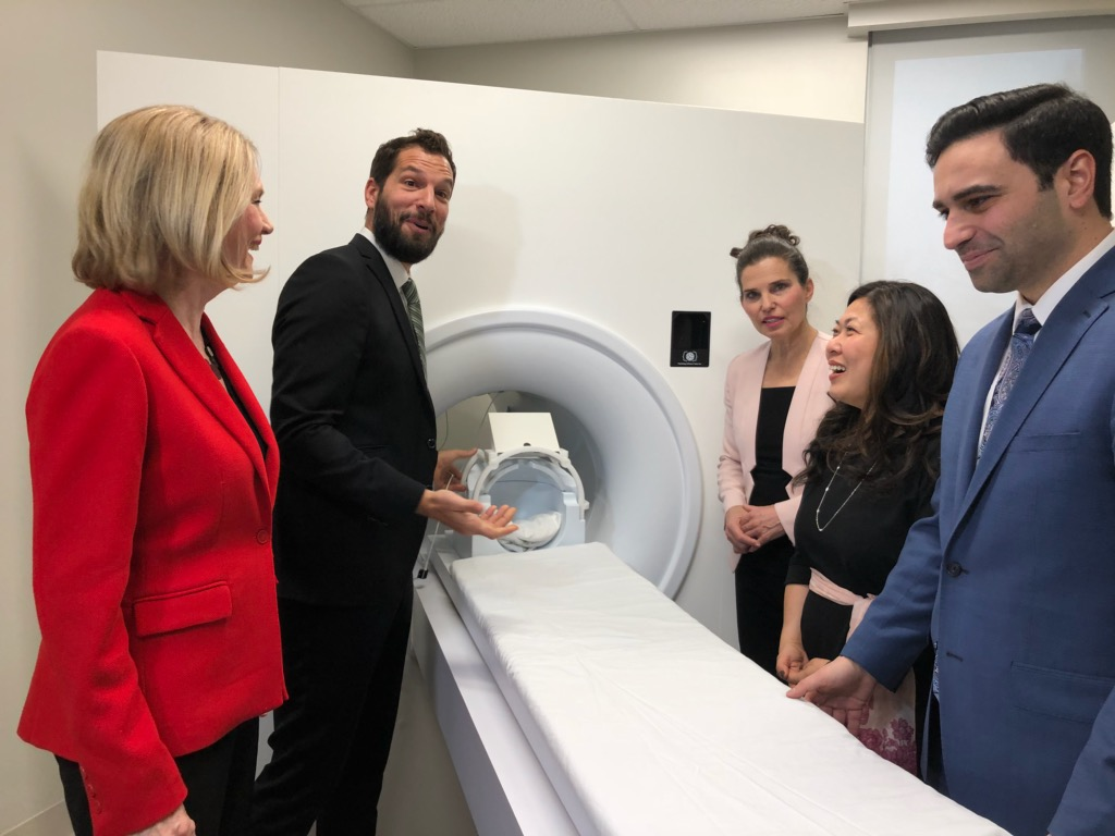 Attendees in front of a model MRI machine